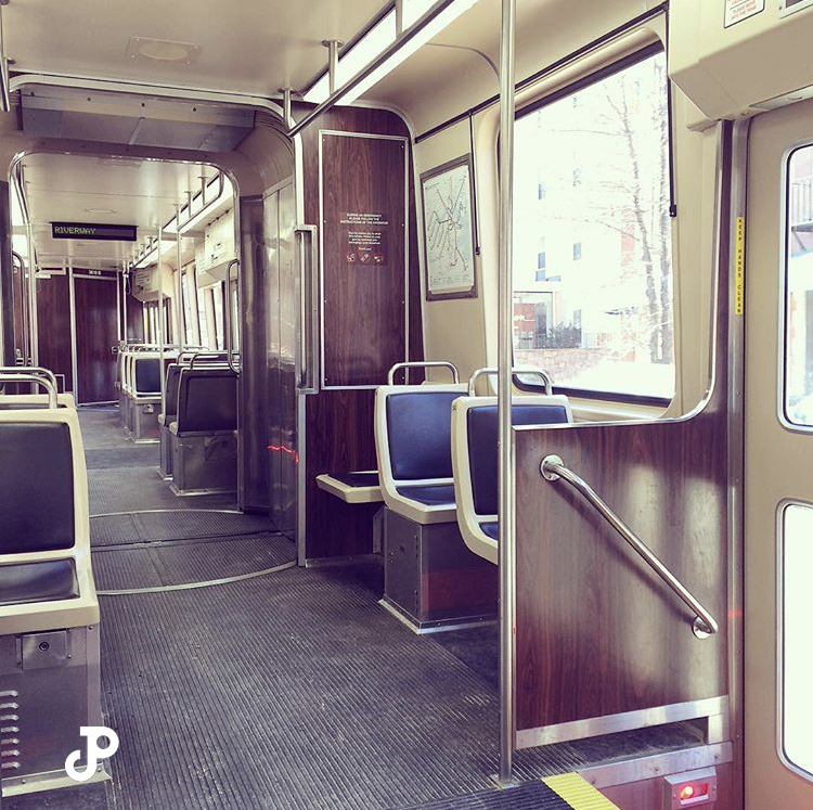 the interior of a subway car on the Green Line