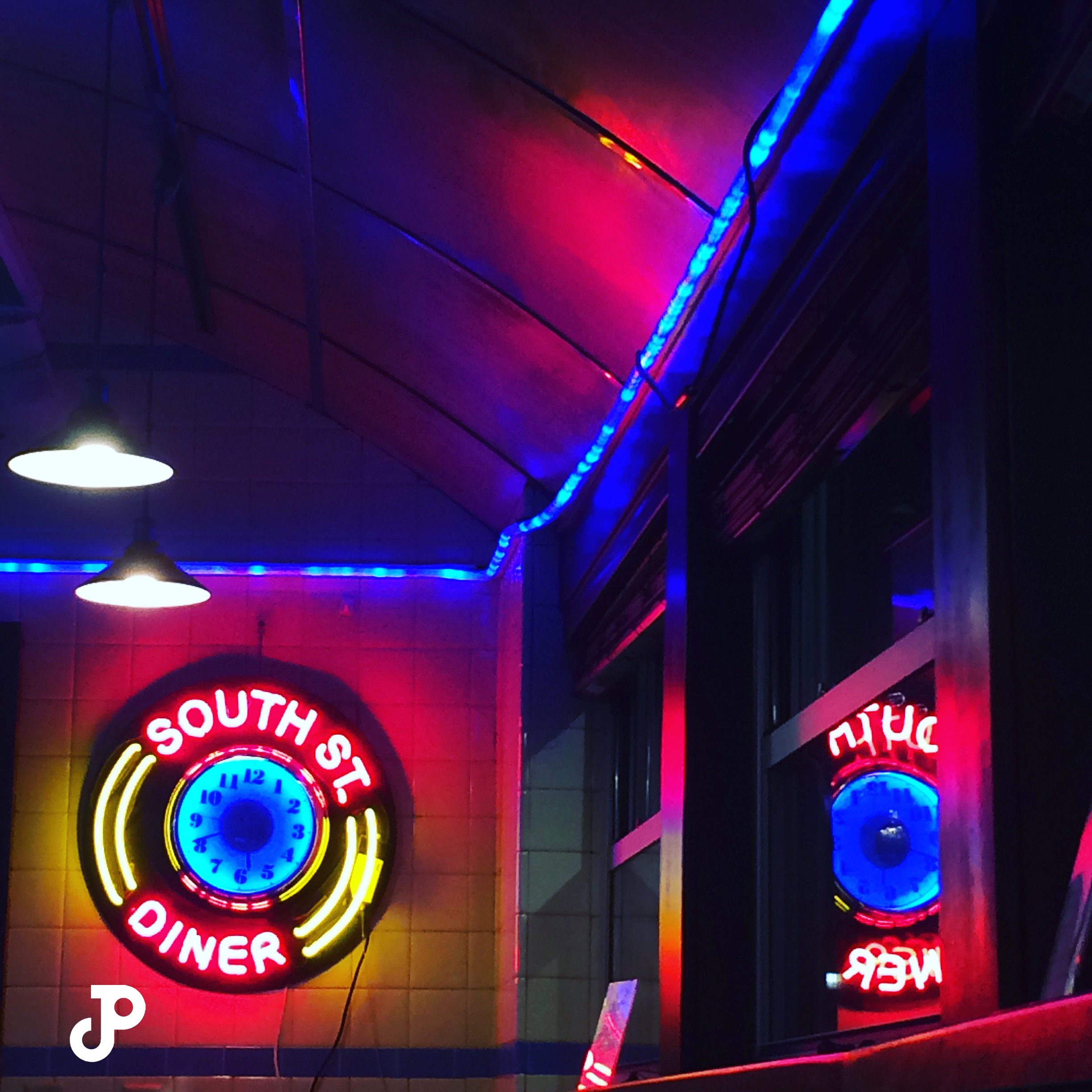 a bright neon sign that reads, South Street Diner