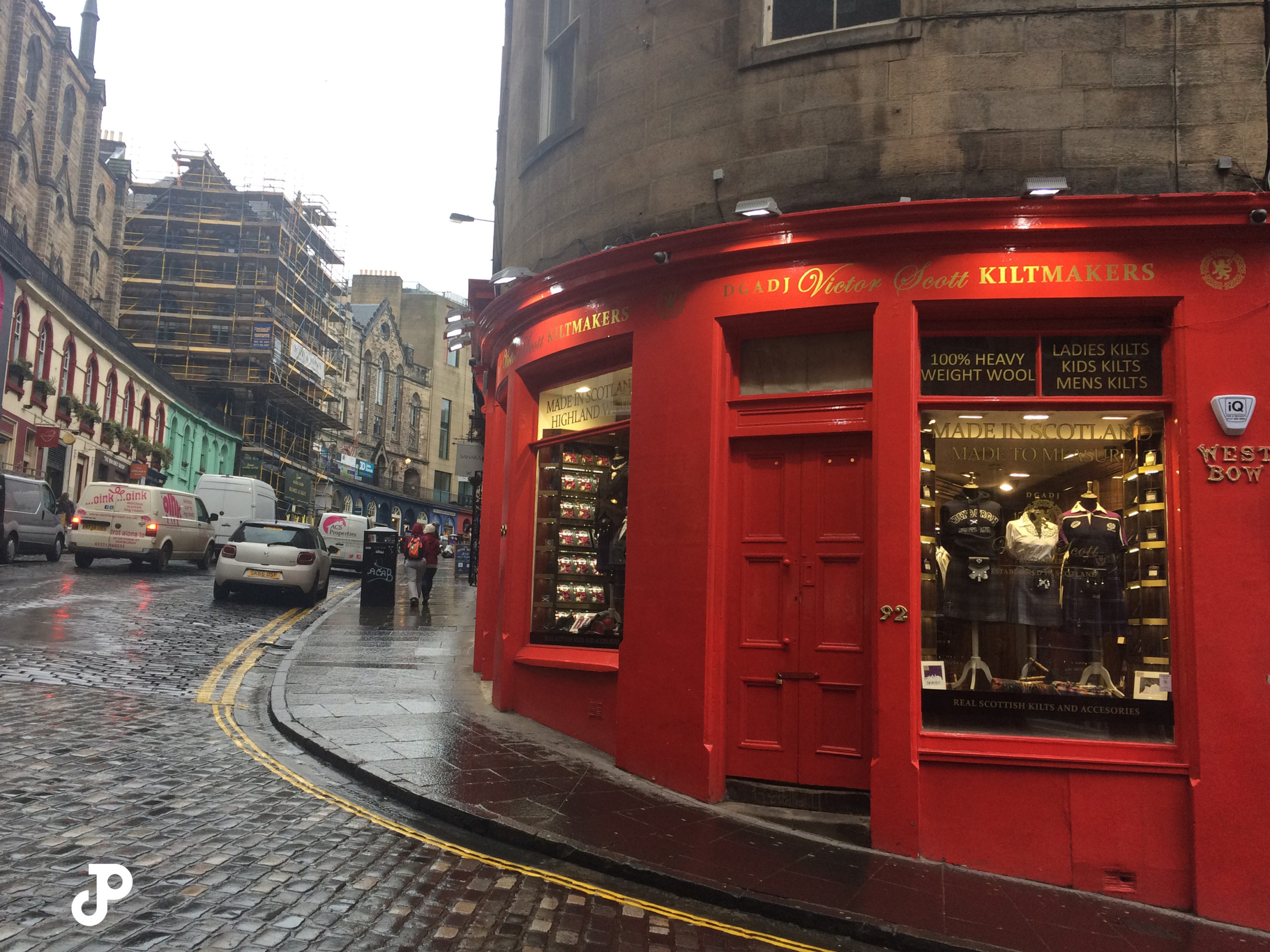 a kilt shop on an upward curving, cobblestoned road