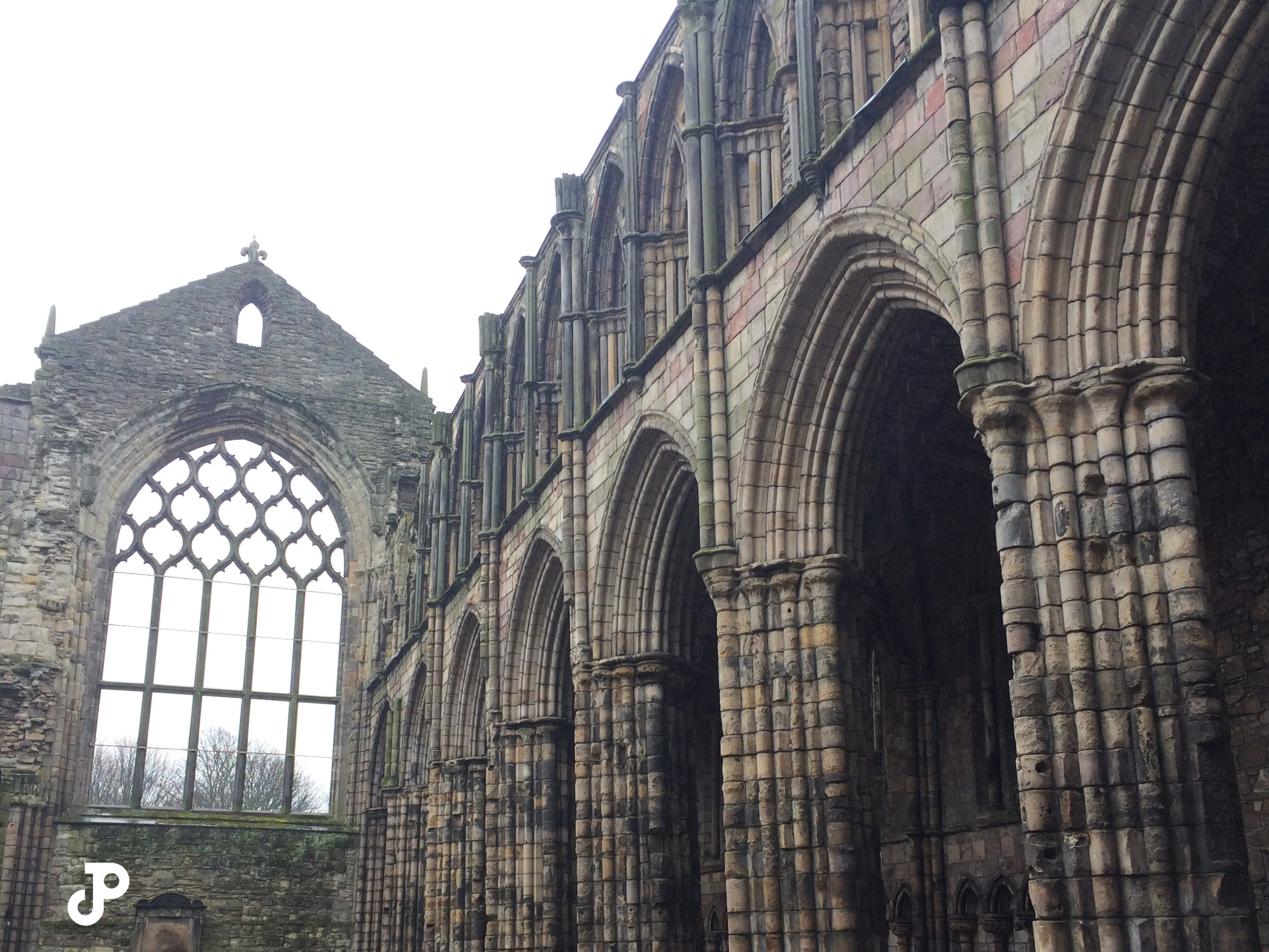 the ruins of Holyrood Abbey, comprising towering gothic arches