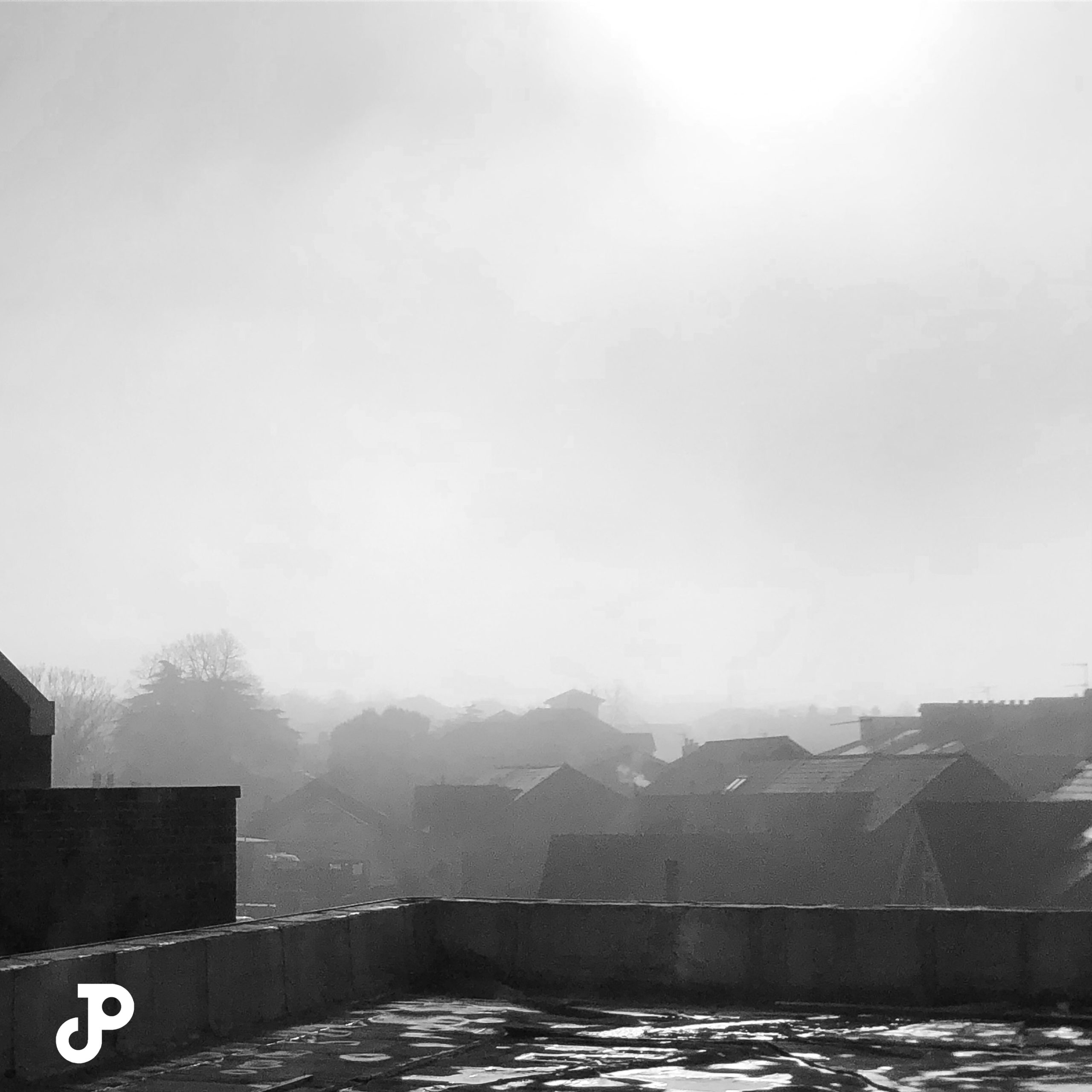 rooftops on a foggy, overcast day in Kingston Upon Thames
