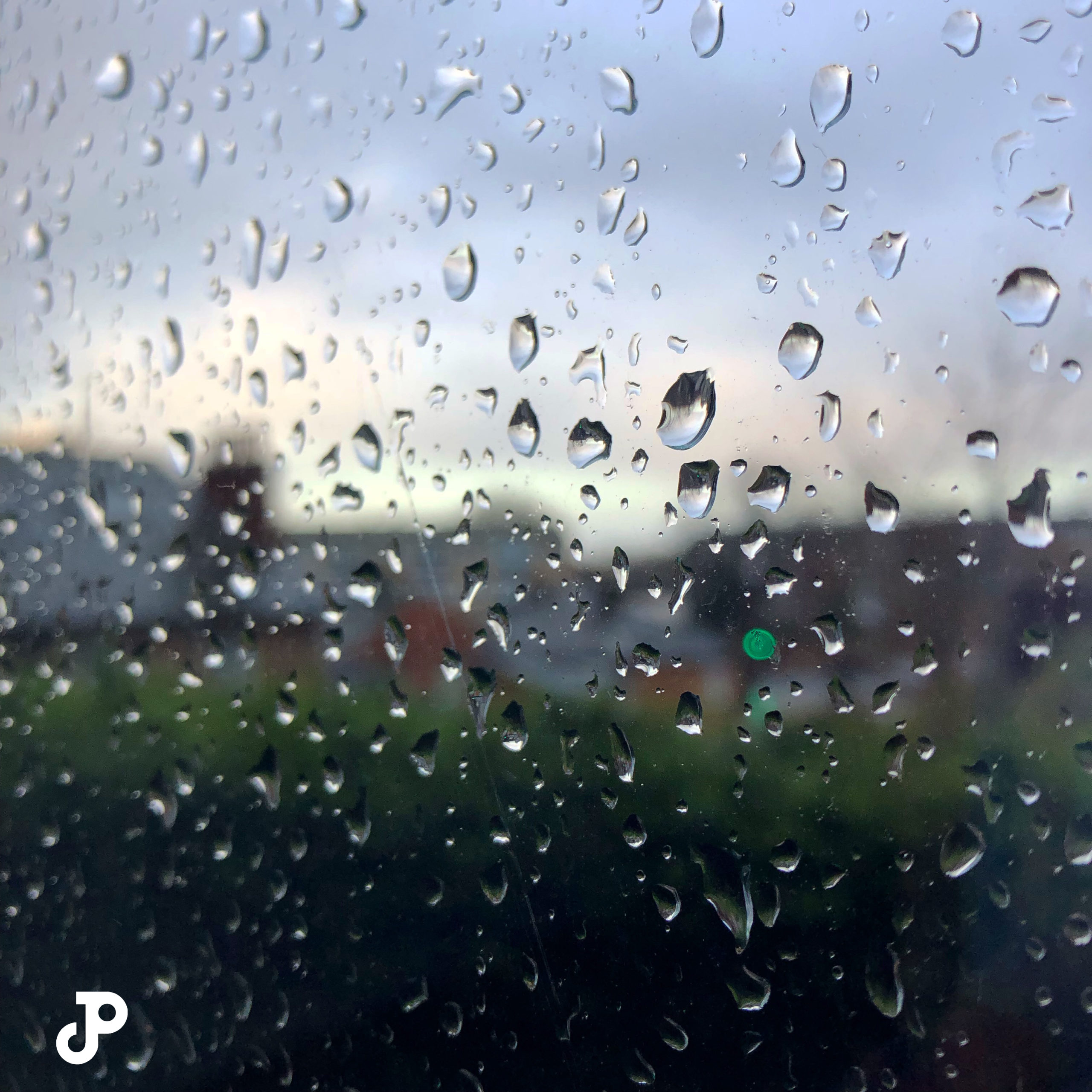 a windowpane splattered with raindrops