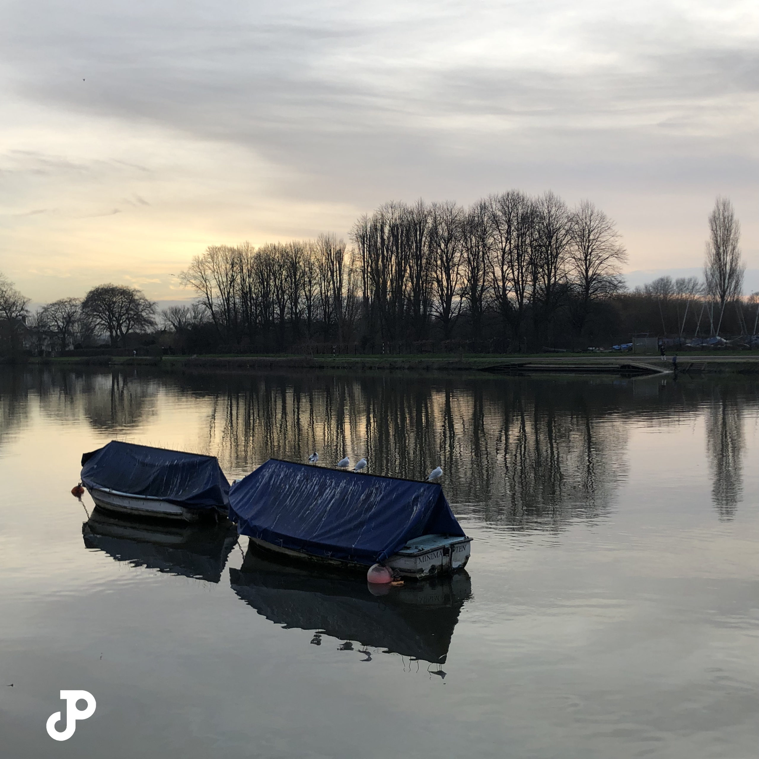 two small boats docked on the River Thames in Kingston Upon Thames