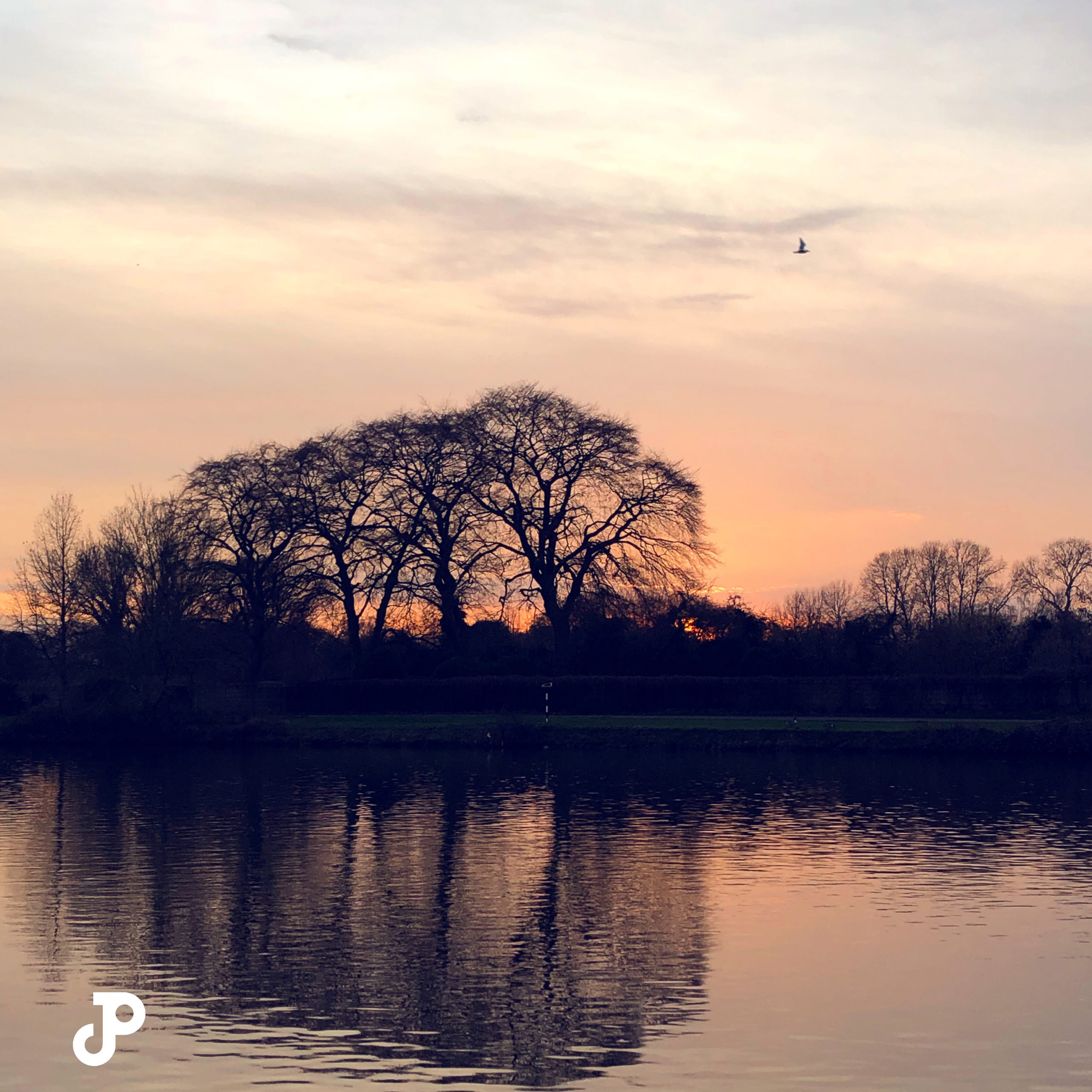 a vibrant orange and pink sunset over the River Thames in Kingston Upon Thames