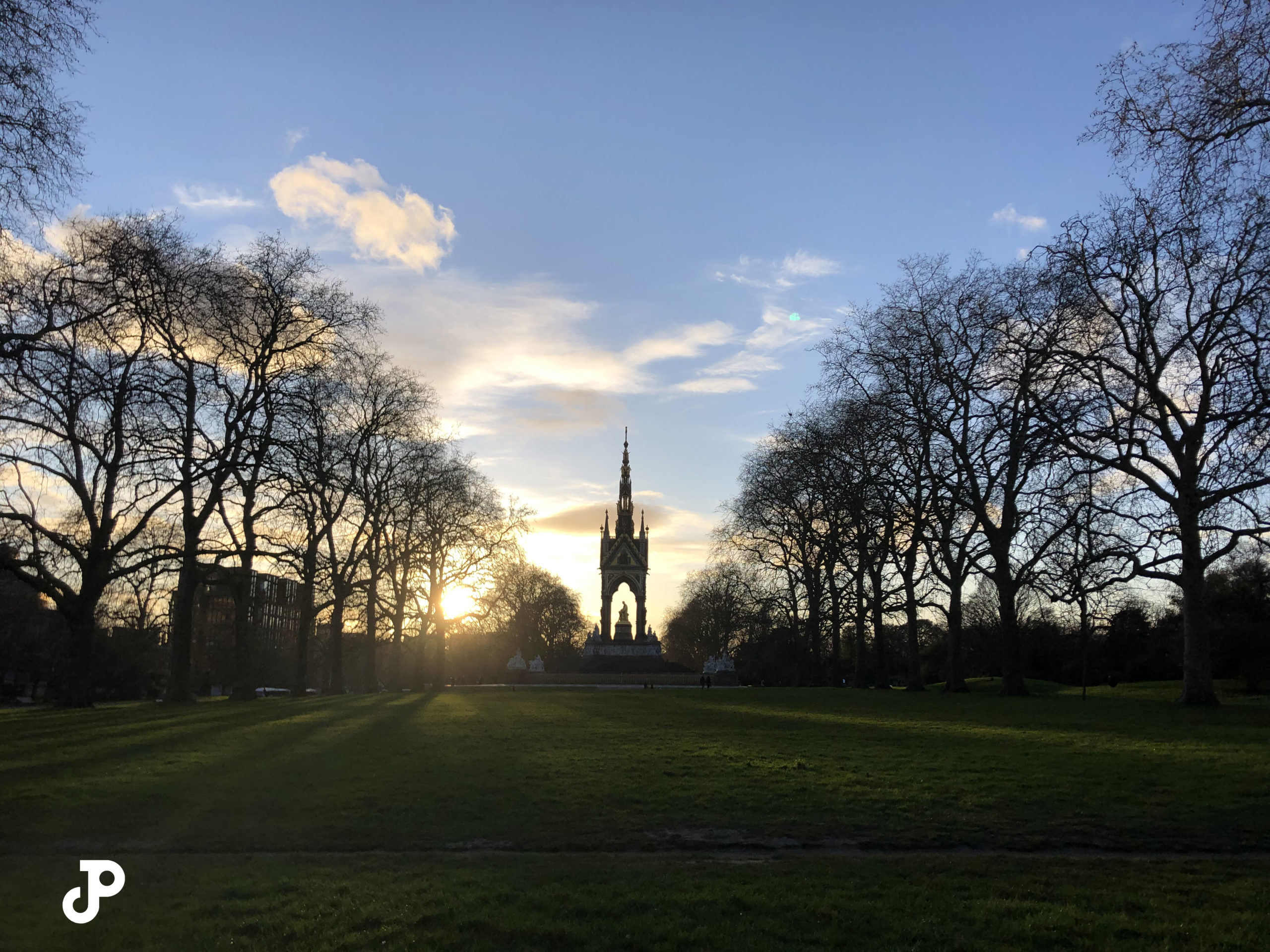 a grassy park with the Albert Memorial in the distance
