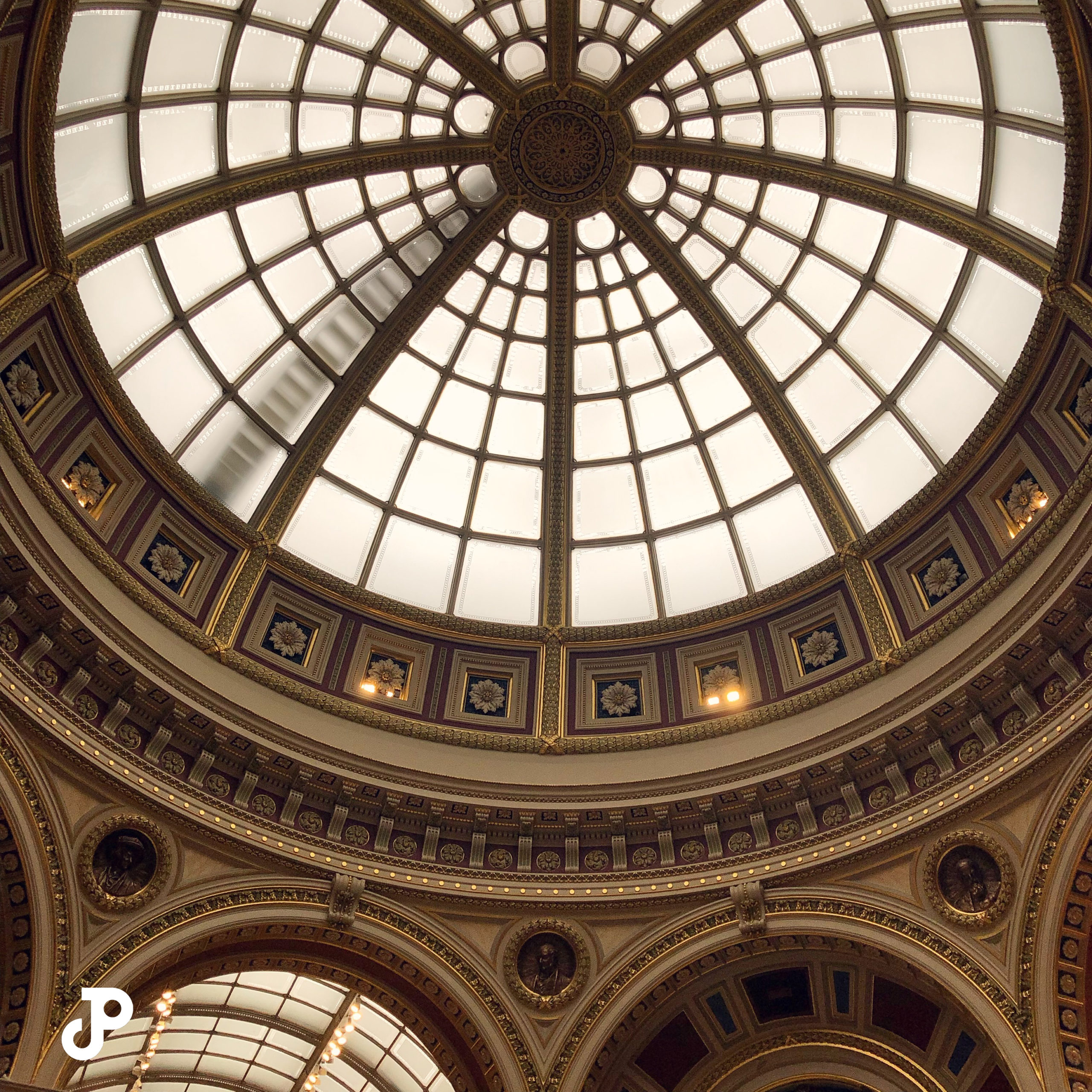 a view from below an ornate circular dome in the National Gallery in London
