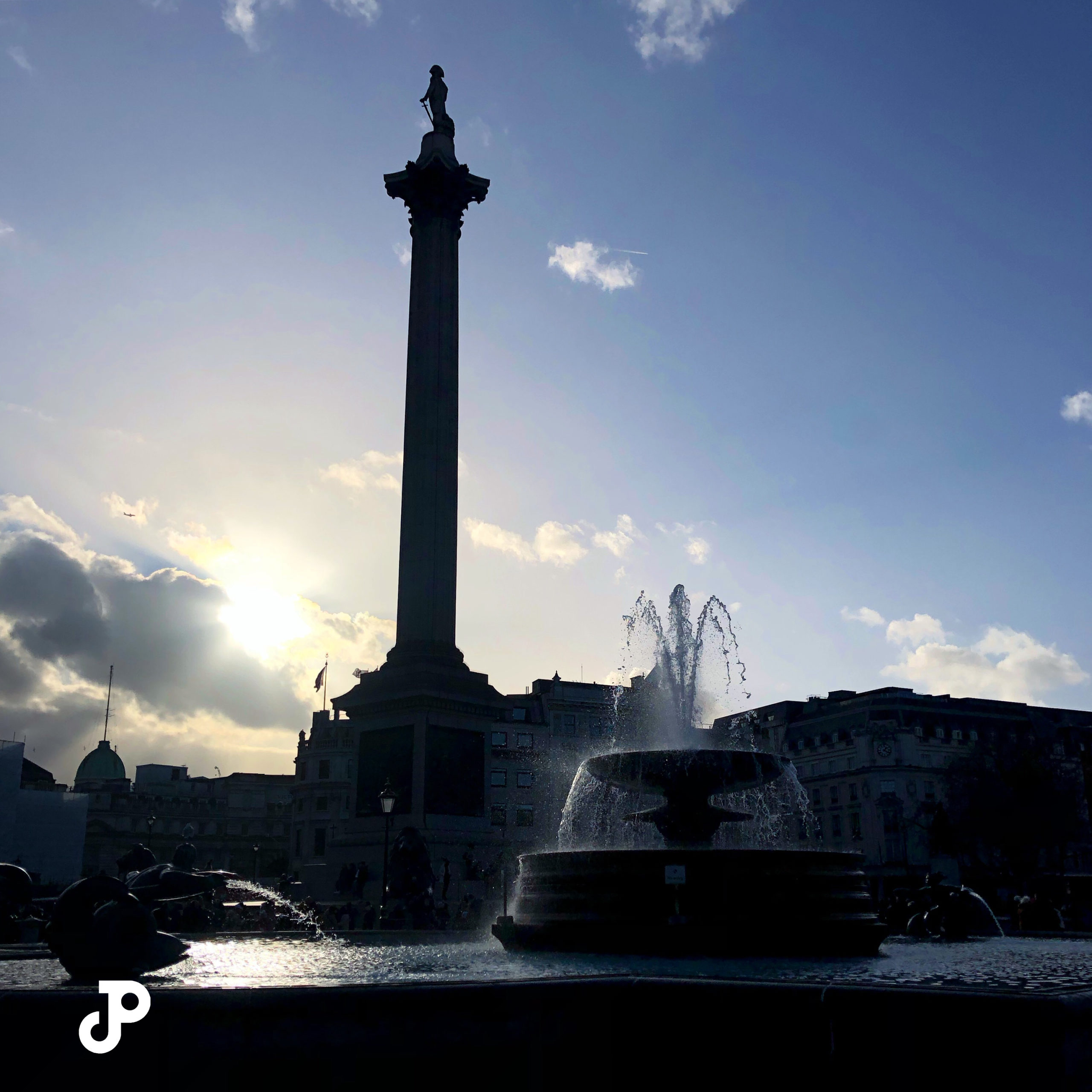 a shadowed view of Nelson's Column in Trafalgar Square, London