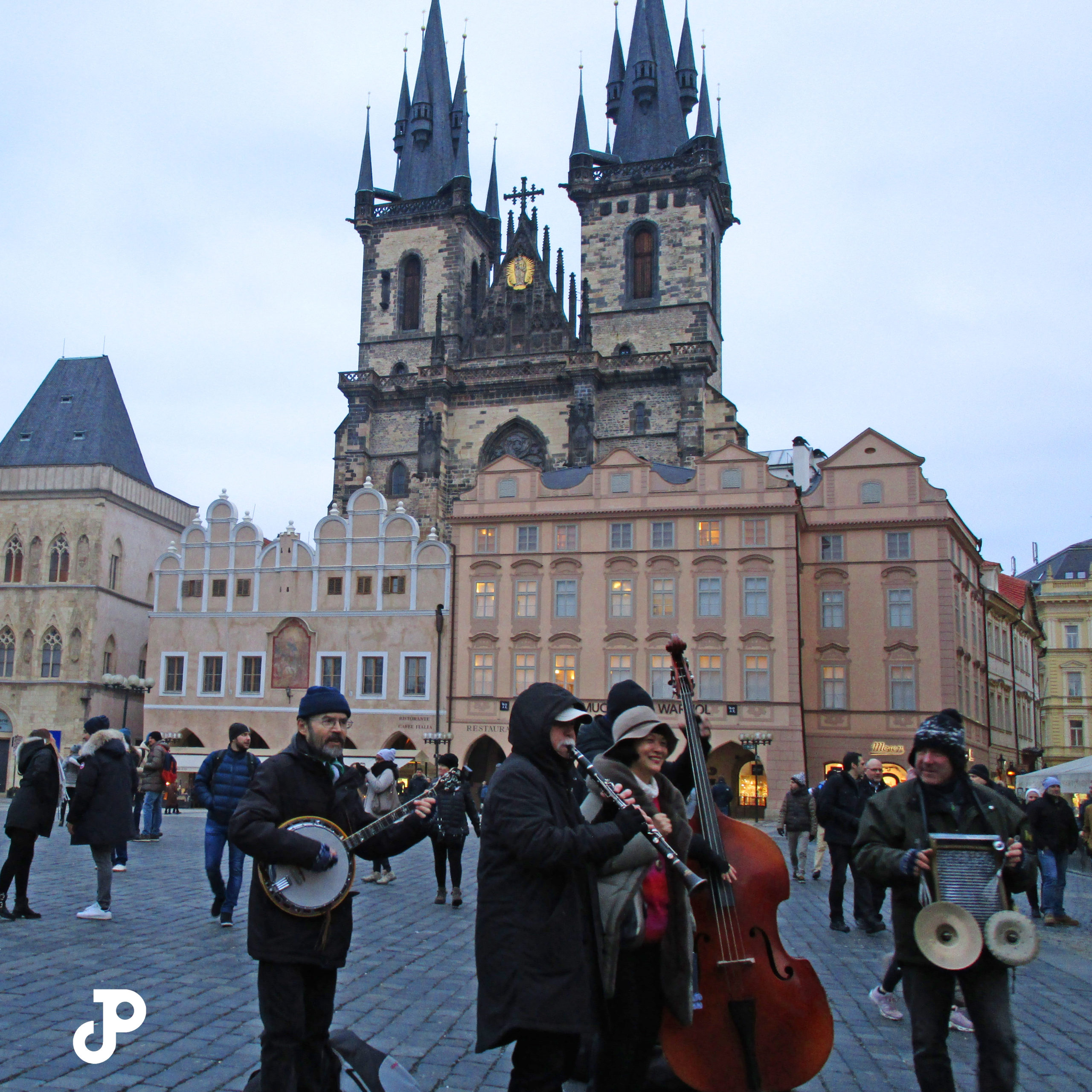 four musicians play in Old Town Square