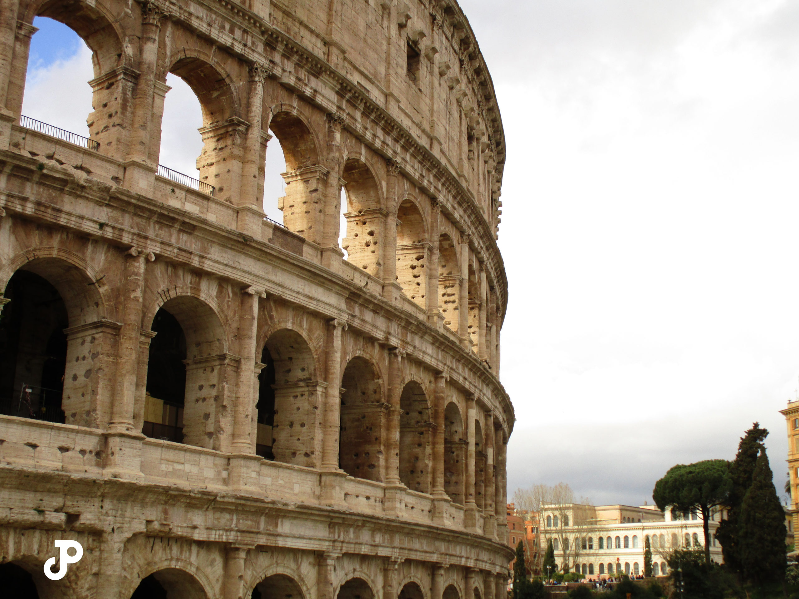 a side view of the Colosseum washed in bright sunlight