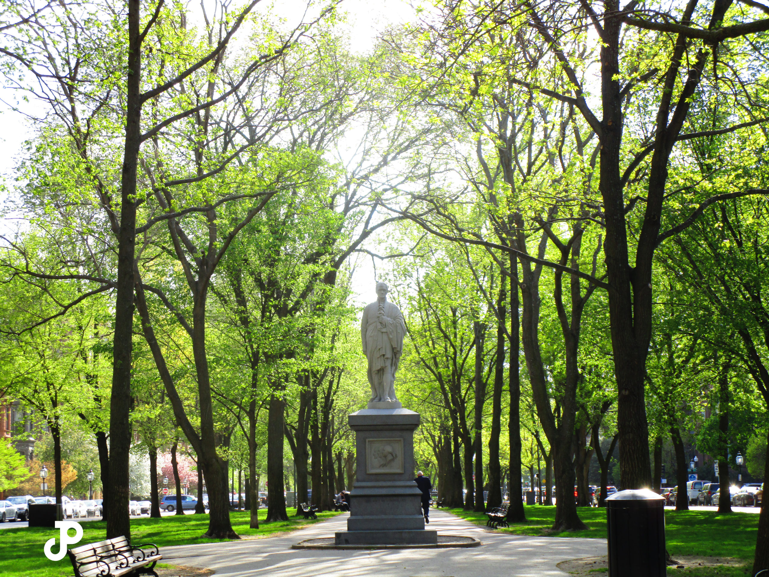 the Alexander Hamilton Statue surrounded by vibrant green trees