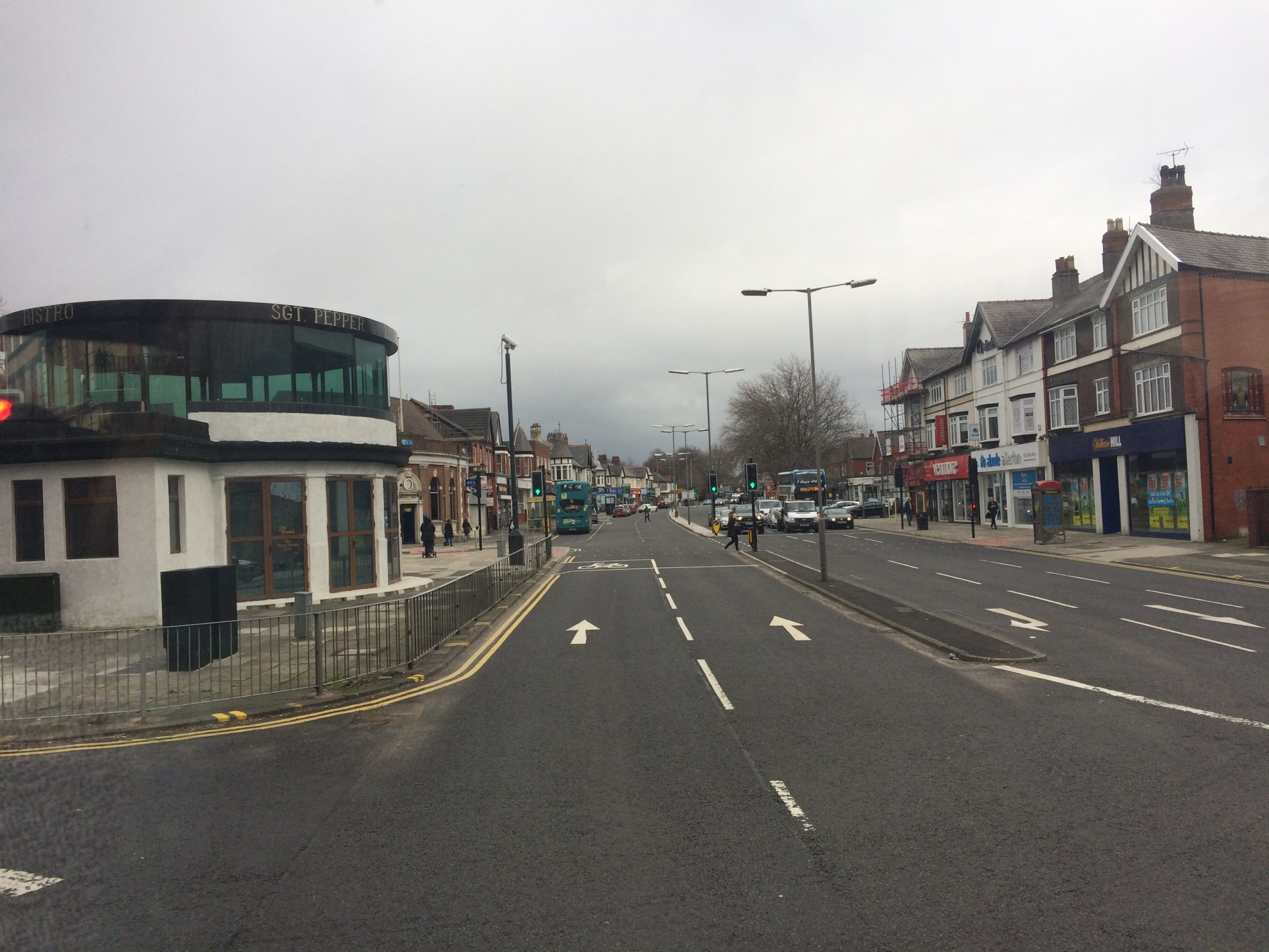 a photo of Penny Lane with the shelter in the roundabout visible to the left